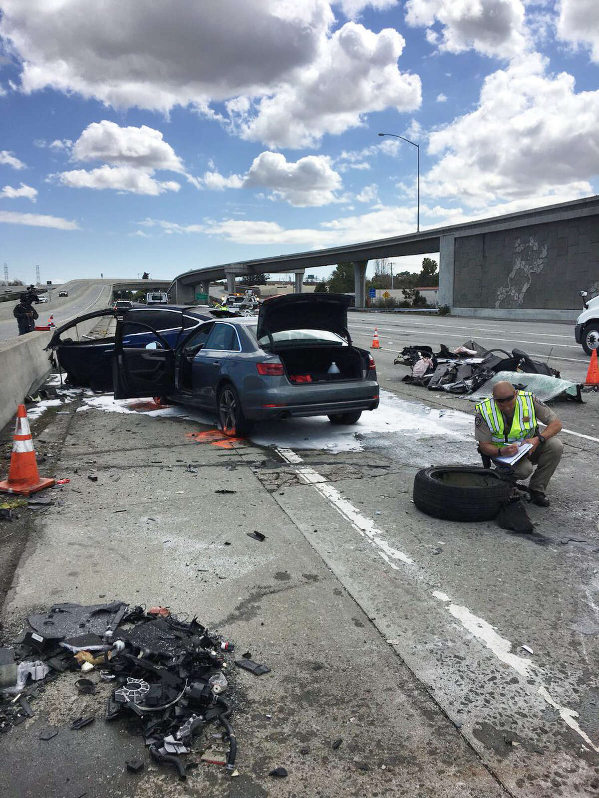 A Tesla Model S was driving southbound on Highway 101 at freeway speeds near Highway 85, the CHP said, when it collided with a barrier separating the carpool lanes on both roads and caught fire.