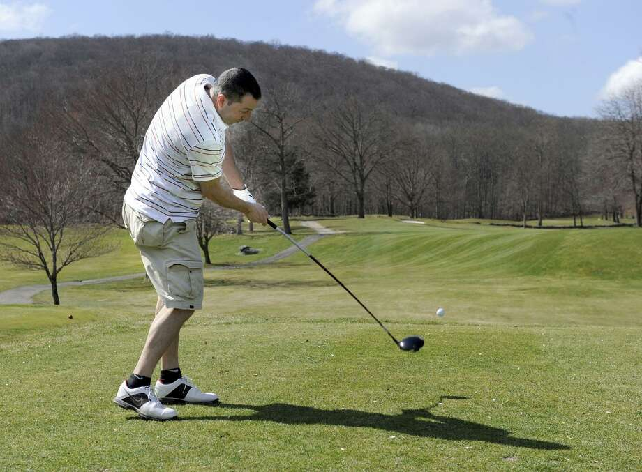 Ray McGarrigal of Danbury drives off the 10th tee at the Richter Park Golf Course Tuesday, March 20, 2012. Photo: Carol Kaliff / Carol Kaliff / The News-Times