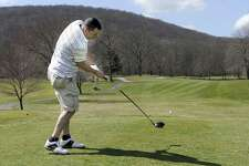 Ray McGarrigal of Danbury drives off the 10th tee at the Richter Park Golf Course Tuesday, March 20, 2012.
