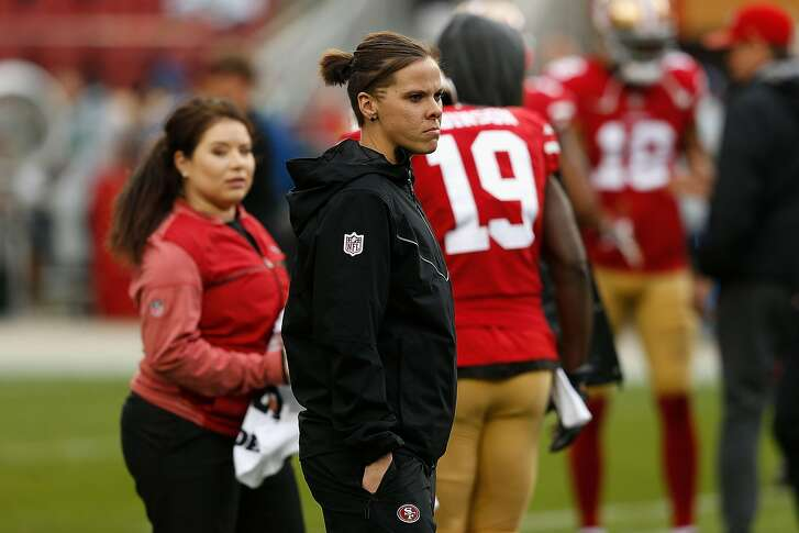 SANTA CLARA, CA - NOVEMBER 26: Seasonal Offensive Assistant Coach Katie Sowers looks on during the warm up before the game against the Seattle Seahawks at Levi's Stadium on November 26, 2017 in Santa Clara, California. (Photo by Lachlan Cunningham/Getty Images)