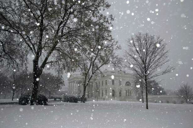 Snow falls outside the White House in Washington, D.C., on March 21, 2018.