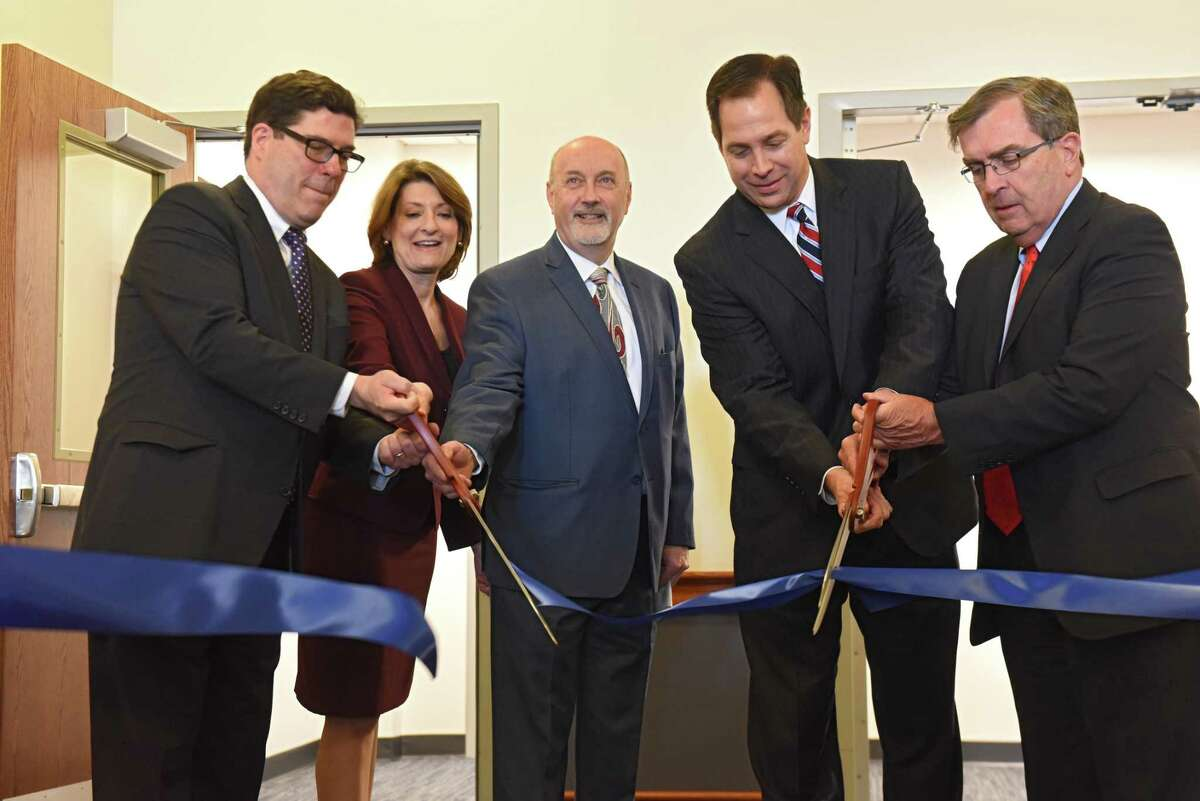 From left, Judge Christopher Maier, Judge Jill Kehn, Troy Mayor Patrick Madden, Judge Matthew Turner and Judge Thomas Breslin cut a ribbon as the Third Judicial District officially opens the new Troy City Court's criminal courtrooms on Friday, March 23, 2018 in Troy, N.Y. (Lori Van Buren/Times Union)