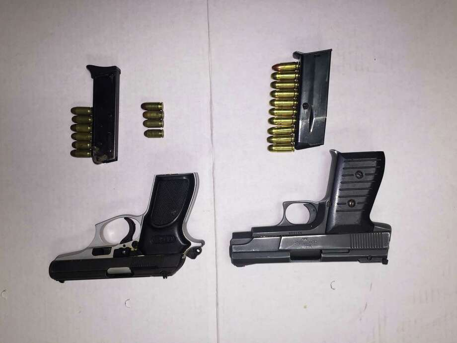 Two guns that were seized when police found them in the possession of Dontraelle Reese, of Stamford. Reese is a convicted felon and prohibited from owning a gun. Photo: Stamford Police / Contributed