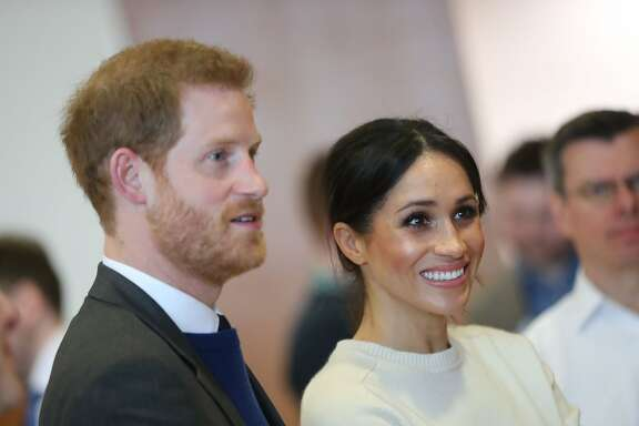 Britain's Prince Harry (L) and Prince Harry's fiancee, US actress Meghan Markle (R) speak with staff during a visit to Northern Irelands next generation science park, Catalyst Inc. in Belfast on March 23, 2018, during the royal couple's first joint visit to Northern Ireland. / AFP PHOTO / POOL / Niall CARSONNIALL CARSON/AFP/Getty Images