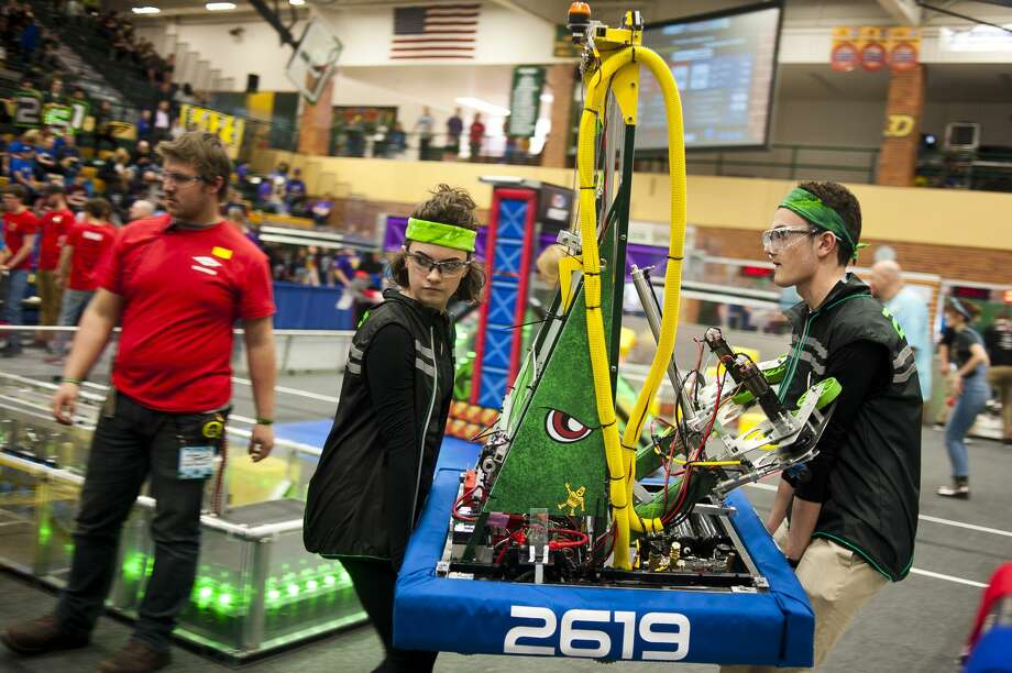 Dow junior Isabel Chaput, left, and Ethan Poupard, right, carry their robot onto the arena during the FIRST Robotics District Competition on Friday, March 23, 2018 at H. H. Dow High School. (Katy Kildee/kkildee@mdn.net) Photo: (Katy Kildee/kkildee@mdn.net)