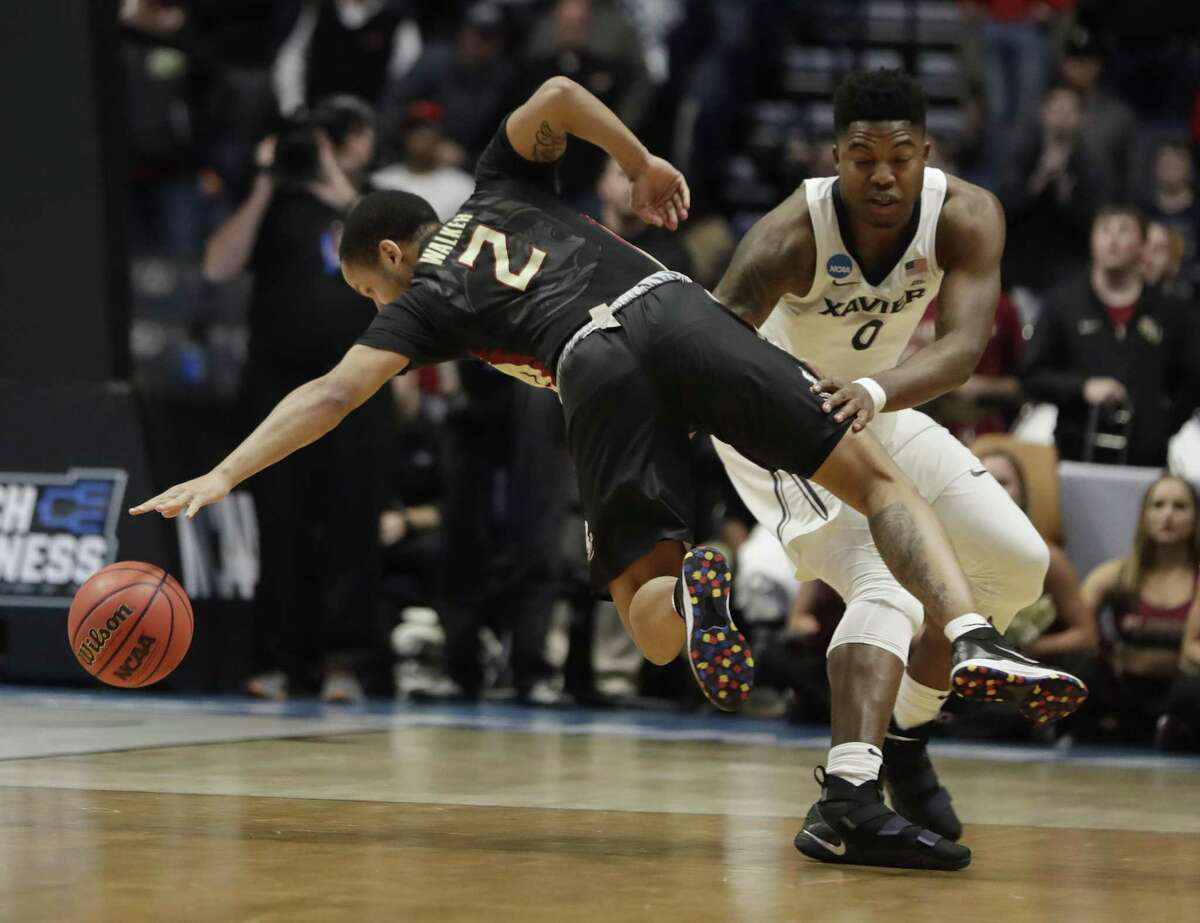Xavier forward Tyrique Jones (0) fouls Florida State guard CJ Walker (2), during the second half of a second-round game in the NCAA college basketball tournament in Nashville, Tenn., March 18. Such players should be paid.
