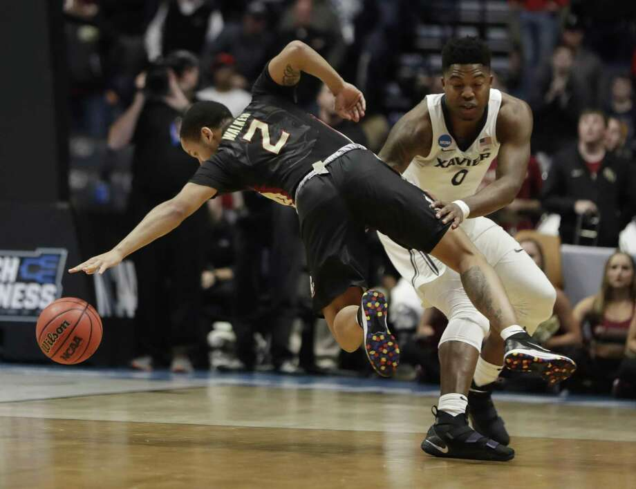 Xavier forward Tyrique Jones (0) fouls Florida State guard CJ Walker (2), during the second half of a second-round game in the NCAA college basketball tournament in Nashville, Tenn., March 18. Such players should be paid. Photo: Mark Humphrey /Associated Press / Copyright 2018 The Associated Press. All rights reserved.