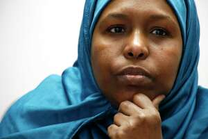 ADVANCE FOR USE MONDAY, MARCH 26, 2018 AND THEREAFTER-Fadumo Hussein, 45, a Muslim refugee from Somalia, listens during an interview in Columbus, Ohio, on Tuesday, Feb. 20, 2018. Weeks before the announcement of President Donald Trump's ban on arrivals from several, mostly Muslim countries, Hussein's parents, who are 75 and 76, had been approved for entry to the U.S. Their arrival was scheduled for February 2017. More than a year later, they remain stuck in Uganda, their case on hold. (AP Photo/Martha Irvine)