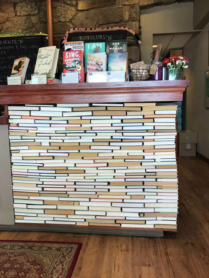 This undated photo shows the check-out counter at the indie bookseller Newtonville Books in Newton, Mass. The counter is made of rows of backwards books glued into place. (Tracee M. Herbaugh via AP) Photo: Tracee M. Herbaugh / Tracee M. Herbaugh