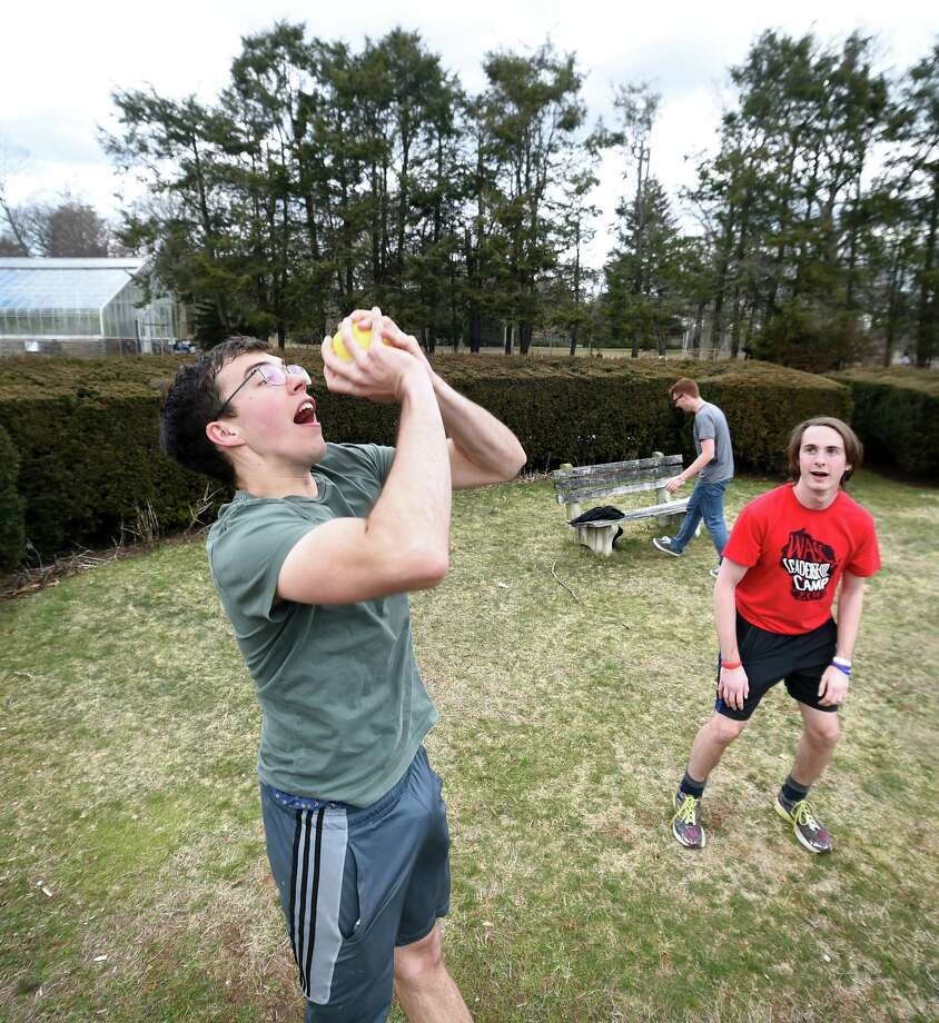 Yale University junior Thomas Zembowicz (center) joins friends near the end of spring break for a game of tappz at Edgerton Park in New Haven on March 23, 2018.  The object of the game is to catch and pass the ball in mid-air to another player. Photo: Arnold Gold, Hearst Connecticut Media / New Haven Register