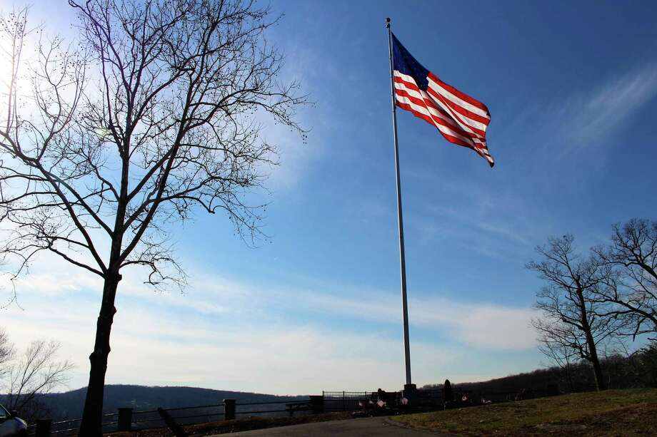 The American flag is back atop French Memorial Park in Seymour. Photo: Jean Falbo-Sosnovich / Hearst Connecticut Media