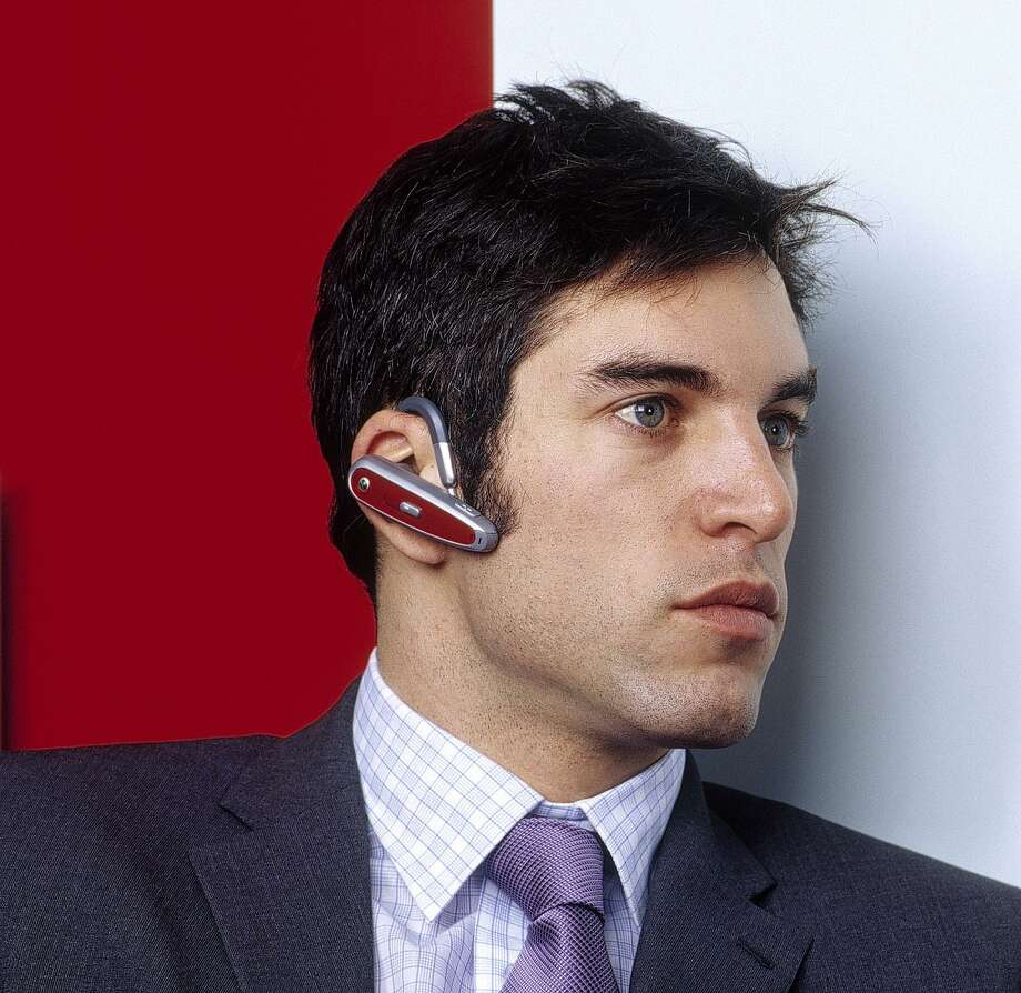 Using cell phone ear pieces may lead to distractions that are both rude and dangerous. Photo: Credit: Handout Image From Sony /Credit: Handout Image From Sony