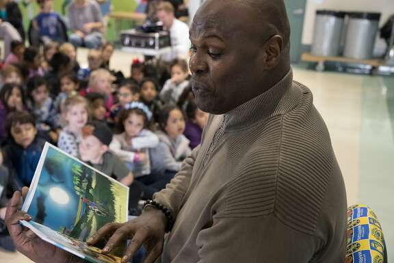 Adonal Foyle reading of his book, for kids at Silverwood Elementary School on Thursday, March 22, 2018 in Concord, CA