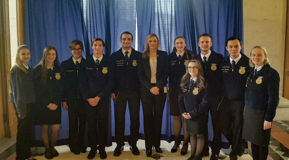 State Rep. Michelle Cook, center, joined students from Northwest Region 7, Wamogo and Housatonic Valley high school vocational agricultural programs during Agriculture Day in Hartford. Photo: Contributed Photo /House Democrats