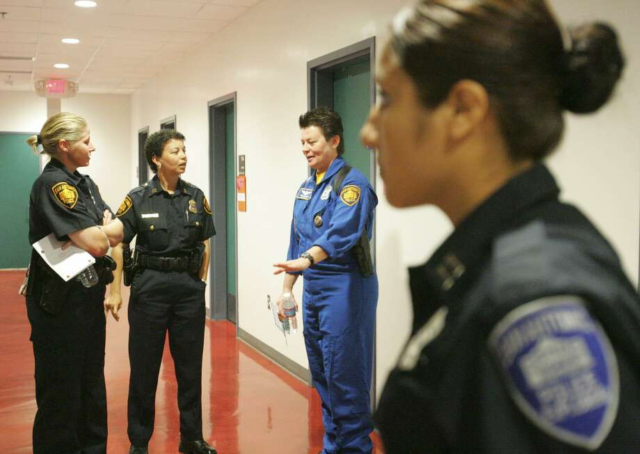 San Antonio Police Department held a recruiting event for women at Palo Alto College in 2009. There has been some incremental progress in total numbers, but of 2,296 officers in the San Antonio Police Department, three women are lieutenants and 11 women have made sergeant. Photo: Delcia Lopez /SPECIAL TO THE EXPRESS-NEWS / SAN ANTONIO EXPRESS-NEWS