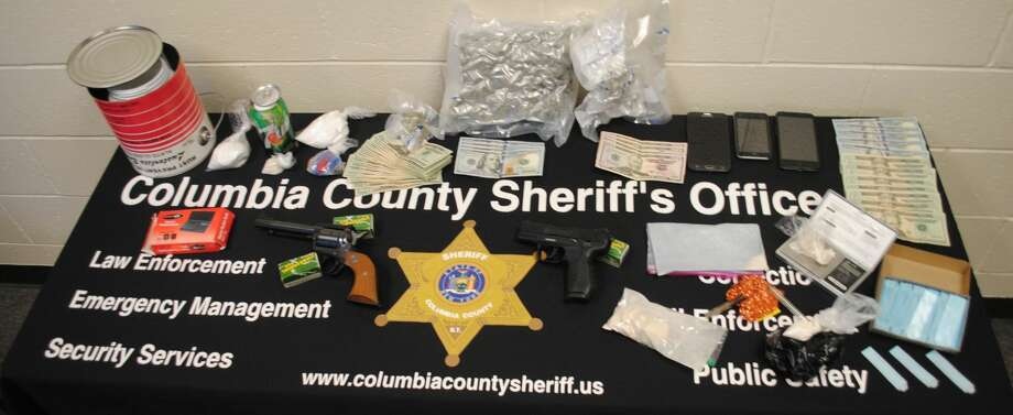The Columbia County Sheriff's Office arrested three suspected drug dealers during the week of March 20, 2018, after seizing drugs, cash and guns during multiple raids planned over the course of six months. Photo: Columbia County Sheriff's Office