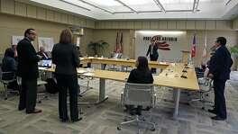 Port San Antonio board members prepare to accept the resignation of CEO Roland Mower.