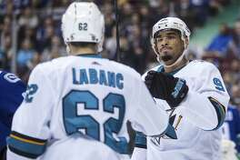 San Jose Sharks' Evander Kane, right, and Kevin Labanc celebrate Labanc's goal against the Vancouver Canucks during the first period of an NHL hockey game Saturday, March 17, 2018, in Vancouver, British Columbia. (Darryl Dyck/The Canadian Press via AP)