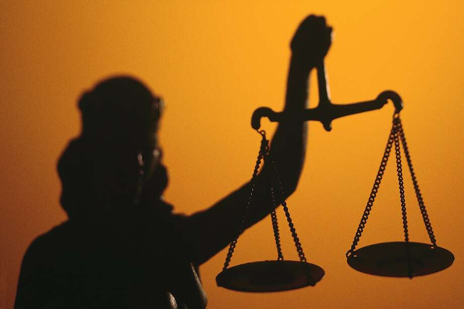 Silhouette of scales of Lady Justice holding scales Photo: Comstock, Getty Images
