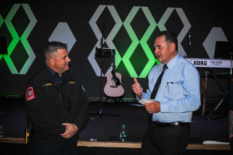 Mike Hanks, right, pastor of Midland First Assembly of God, on March 18 presented a $1,500 check to Midland Fire Department Capt. Jayme Farmer. The donation is for the purchase of bulletproof vests for local firefighters Photo: Courtesy Photo