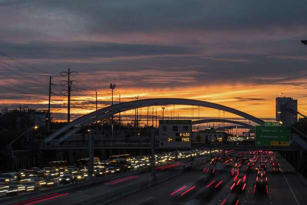 Commuters travel on U.S. 59, under bridges that were once lit up with colorful lights, as the sun sets on Thursday, Jan. 25, 2018, in Houston. The lights have been off the past several days because the Montrose Management District coiuldn't pay its bill. ( Brett Coomer / Houston Chronicle )