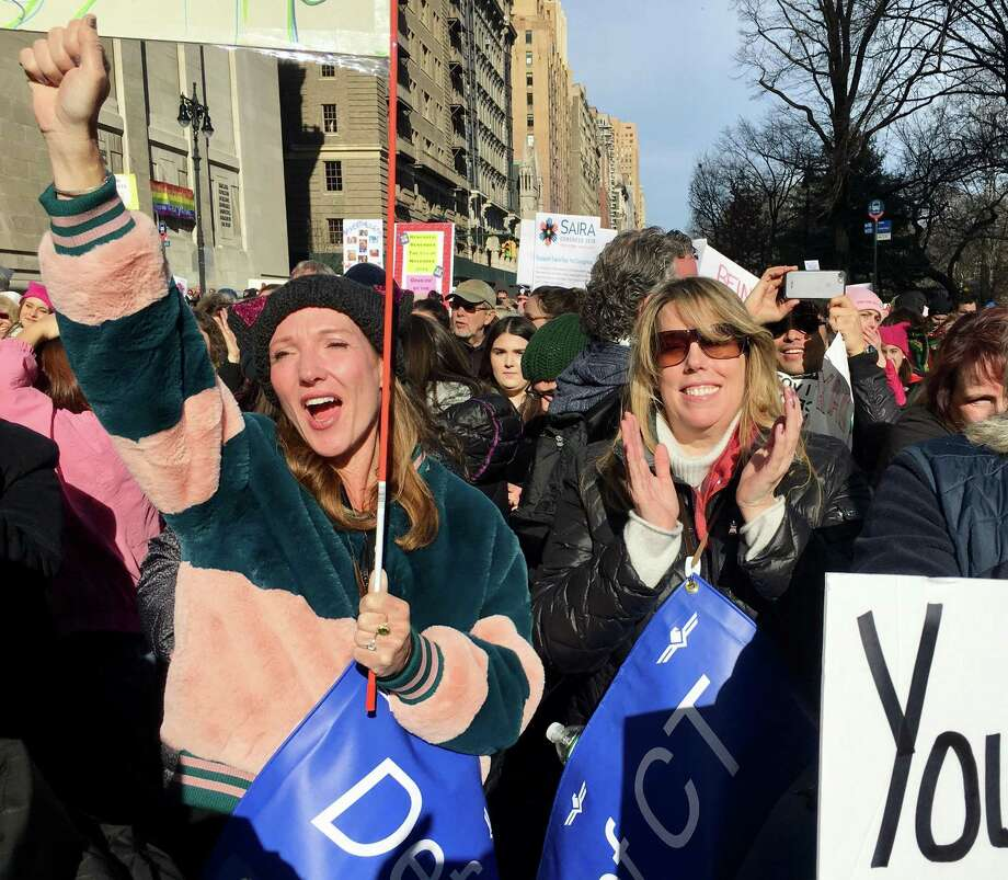 Darcy Hicks, left, of Westport, and Laura Totten of Stamford react to a speech by Whoopi Goldberg in the New York Women's March 2018 in January. Hicks founded DefenDemocracy of Connecticut, a political action group, after the 2017 Womens March. Photo: Dan Haar / Hearst Connecticut Media / Connecticut Post