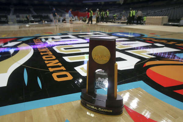 A Final Four trophy is on the floor while the floor for the official court of the 2018 NCAA Men's Final Four is installed Friday March 23, 2018 in the Alamodome in San Antonio, Texas. Connor Sports is the official court provider of the NCAA since 2006. The 2018 Men's Final Four official court is a trademarked custom built floor called QuickLock and is manufactured from northern hard maple timber from forests in Michigan. The court is 70 feet by 140 feet and is made by using 397 4-foot by 7-foot panels each weighing 188 pounds.