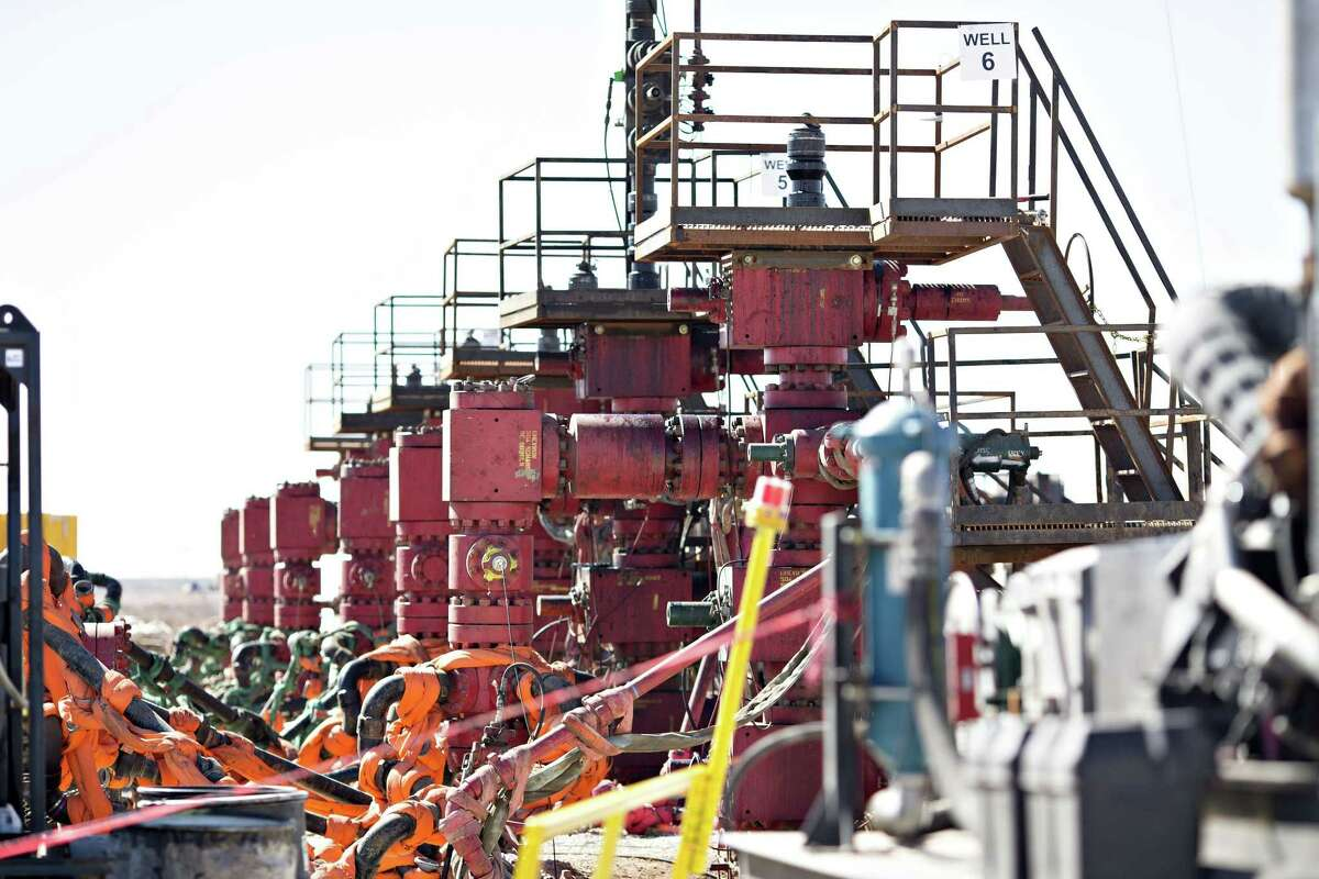 Six Chevron Corp. oil wells being readied for hydraulic fracturing stand in the Permian Basin near Midland, Texas, U.S., on Thursday, March 1, 2018.