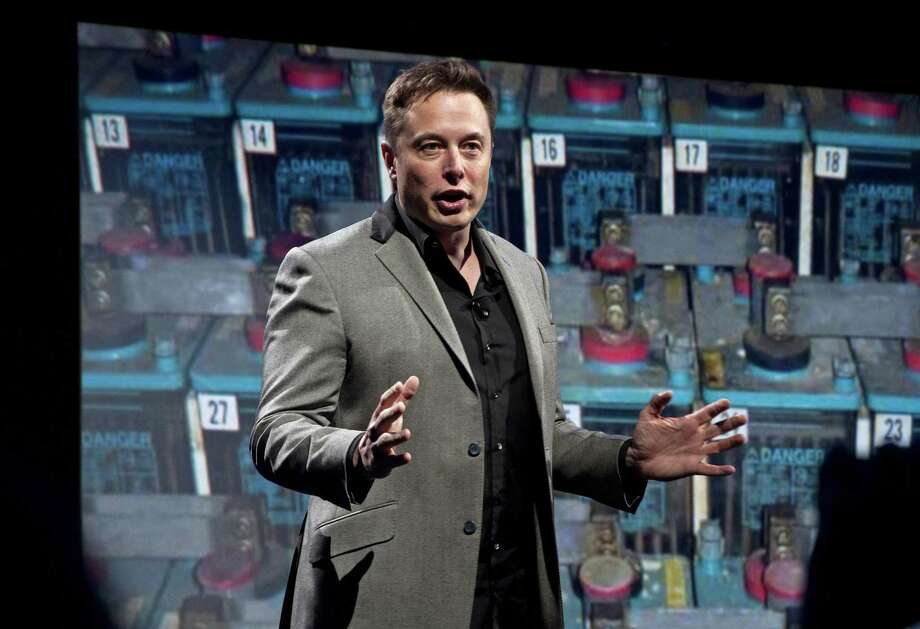 In a April 30, 2015 file photo, Tesla Motors CEO and SpaceX CEO and CTO Elon Musk introduces a new line of residential and commercial batteries at his design studio in Hawthorne, Calif. Musk made waves Friday saying in a Twitter exchange that he would take down the Facebook sites for his companies Tesla and SpaceX. Photo: Jerome Adamstein /TNS / Los Angeles Times