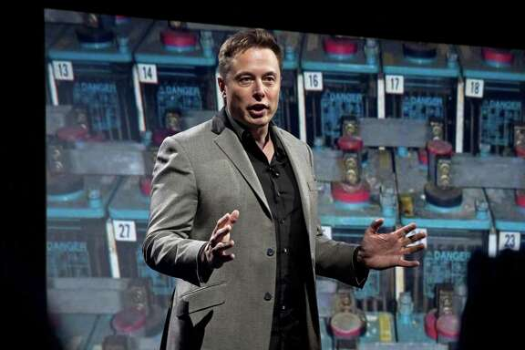 In a April 30, 2015 file photo, Tesla Motors CEO and SpaceX CEO and CTO Elon Musk introduces a new line of residential and commercial batteries at his design studio in Hawthorne, Calif. Musk made waves Friday saying in a Twitter exchange that he would take down the Facebook sites for his companies Tesla and SpaceX.