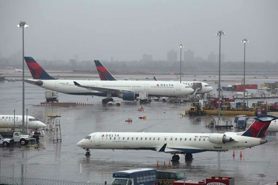 Delta airplanes are grounded, Friday, March 2, 2018, in New York.  Photo: Mark Lennihan, AP / Copyright 2018 The Associated Press. All rights reserved.