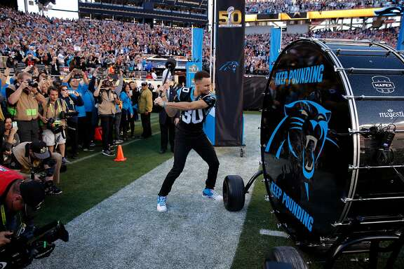 The Golden State Warriors' Stephen Curry gets the Carolina fans worked up by beating a drum before the start of the game, as the Denver Broncos prepare to take on the Carolina Panthers in Super Bowl 50 at Levi's Stadium in Santa Clara, Calif., on Sun. February 7, 2016.