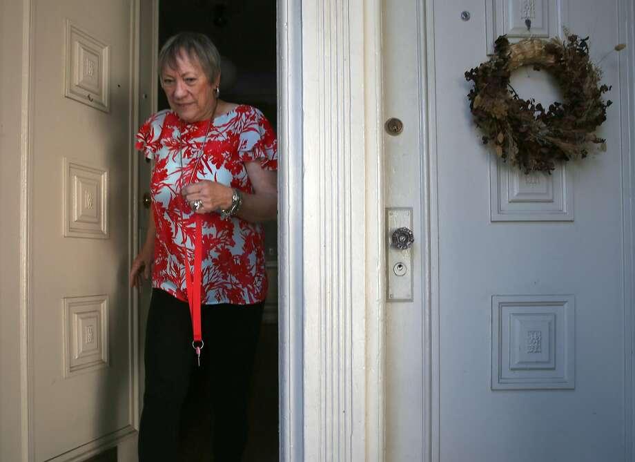 Airbnb host Karen Cancino checks her San Francisco home. Photo: Liz Hafalia, The Chronicle
