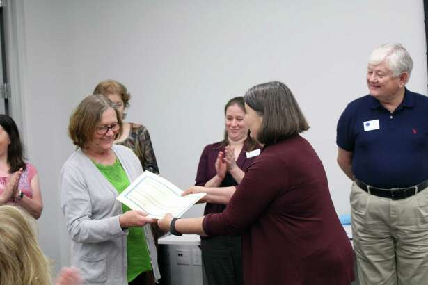 Bonnie Langan, treasurer for Baldwin Boettcher Branch Library, is presented with a check for$1,875 byHCPL Friends of the Library Treasurer, Marianne Kolar,during the annual Harris County Friends of the Library meeting on March 23 at the HPCL Administrative Offices in Houston.