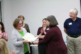 Bonnie Langan, treasurer for Baldwin Boettcher Branch Library, is presented with a check for $1,875 by HCPL Friends of the Library Treasurer, Marianne Kolar, during the annual Harris County Friends of the Library meeting on March 23 at the HPCL Administrative Offices in Houston.