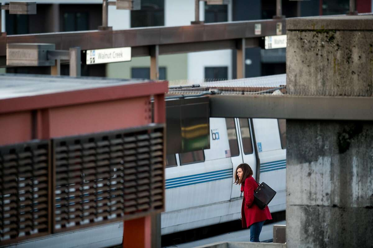 A commuter waits for a train at the Walnut Creek BART station on Friday, March 23, 2018, in Walnut Creek, Calif.