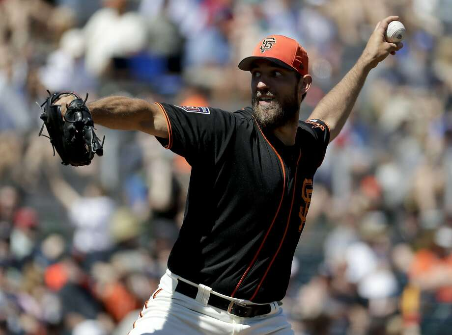 Giants starting pitcher Madison Bumgarner throws against the Royals during the first inning of a spring training game on Friday, March 23, 2018. Photo: Chris Carlson, Associated Press