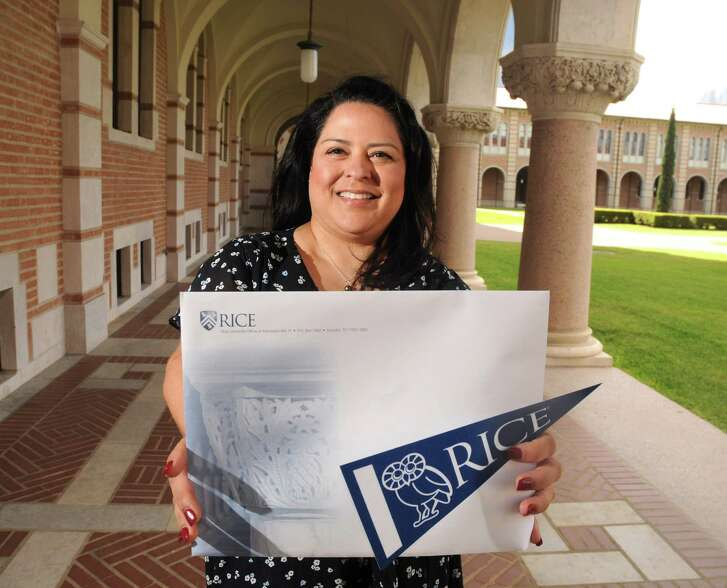 Rice University Vice President of Admissions  Yvonne Romero da Silva with an acceptance package outside her office Friday March 23,2018. (Dave Rossman Photo)