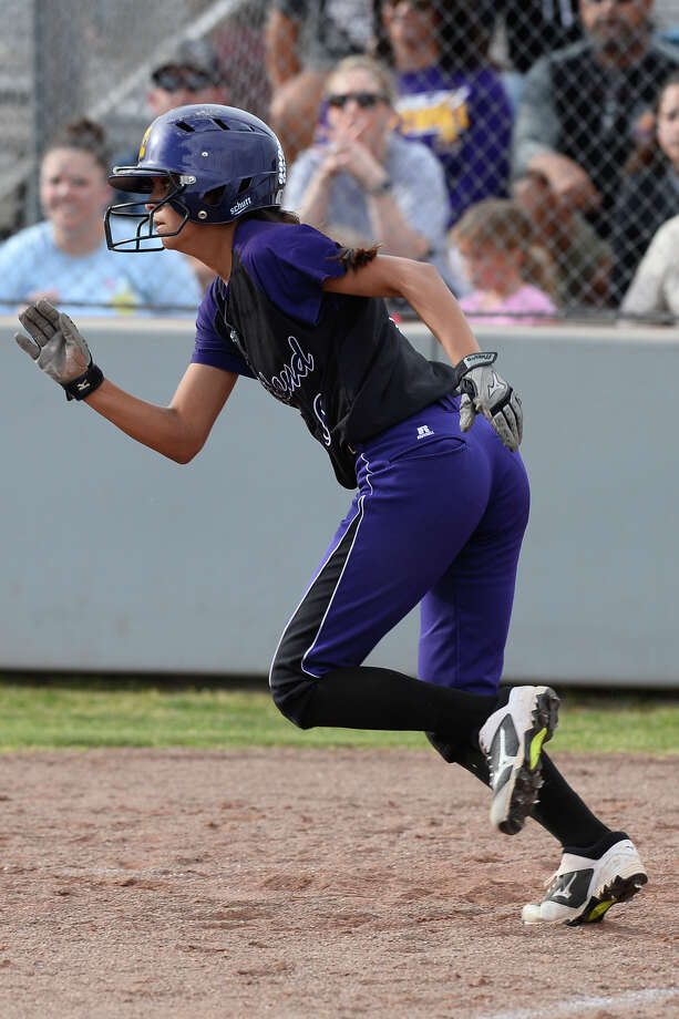 Midland High's Alyssa Flores runs after hitting against Lee March 23, 2018, at Gene Smith Field.  James Durbin/Reporter-Telegram Photo: James Durbin
