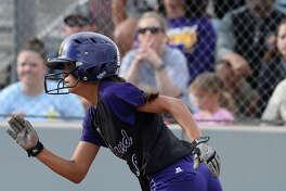 Midland High's Alyssa Flores runs after hitting against Lee March 23, 2018, at Gene Smith Field.  James Durbin/Reporter-Telegram
