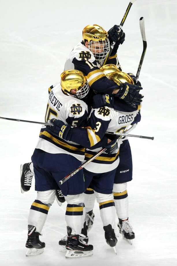 Notre Dame players celebrate a goal by Jordan Gross (No. 3) on Friday. Photo: Ned Gerard / Hearst Connecticut Media / Connecticut Post