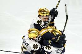 Notre Dame players celebrate a goal by Jordan Gross (No. 3) on Friday.