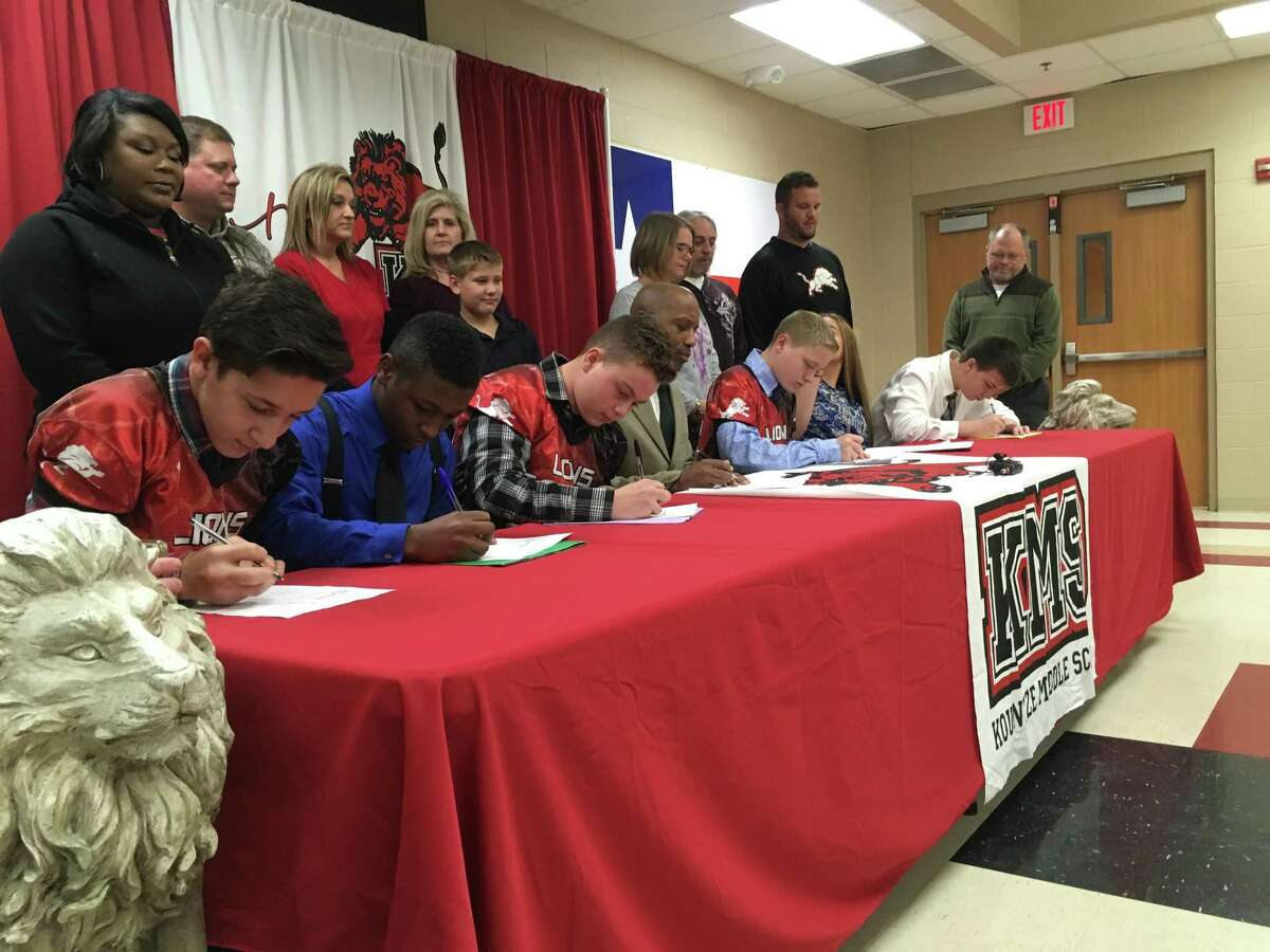 Students at Kountze Middle School, joined by state Rep. James White, in the center, signed a pledge on Dec. 7, 2017, to treat women with respect as part of a new program aimed at preventing violence against women.