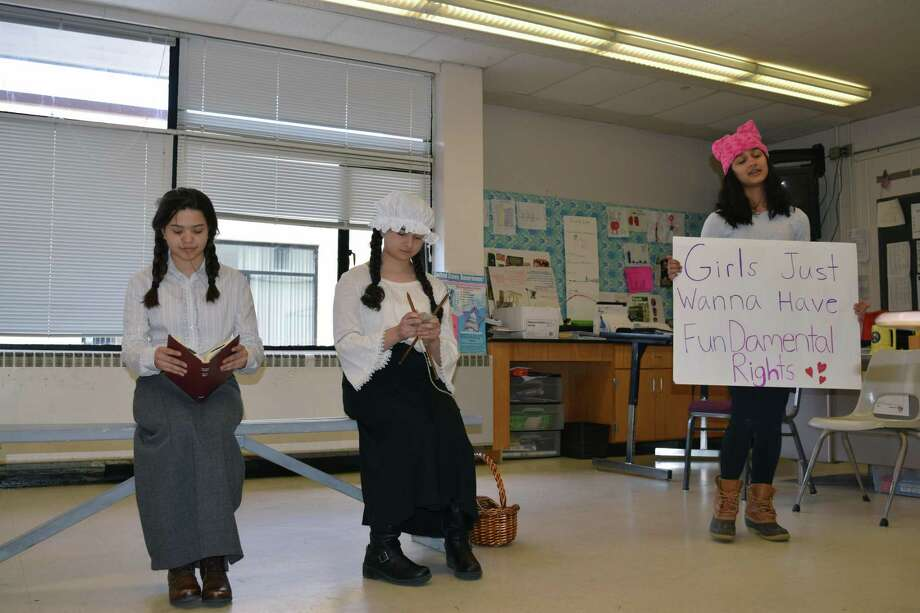 Torrington High School students participated in the annual Connecticut History Day competition on March 10. Above, a trio of young women present their project to the audience. Photo: Contributed Photo /Connecticut History Day
