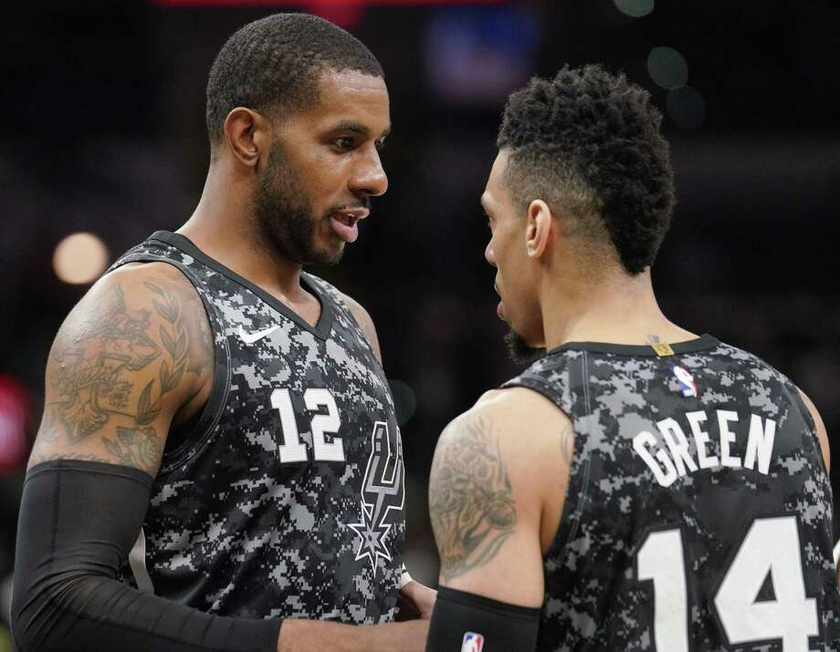 San Antonio Spurs' LaMarcus Aldridge (12) and Danny Green talk during the first half of the team's NBA basketball game against the Washington Wizards, Wednesday, March 21, 2018, in San Antonio. Photo: Darren Abate /Associated Press / FR115 AP
