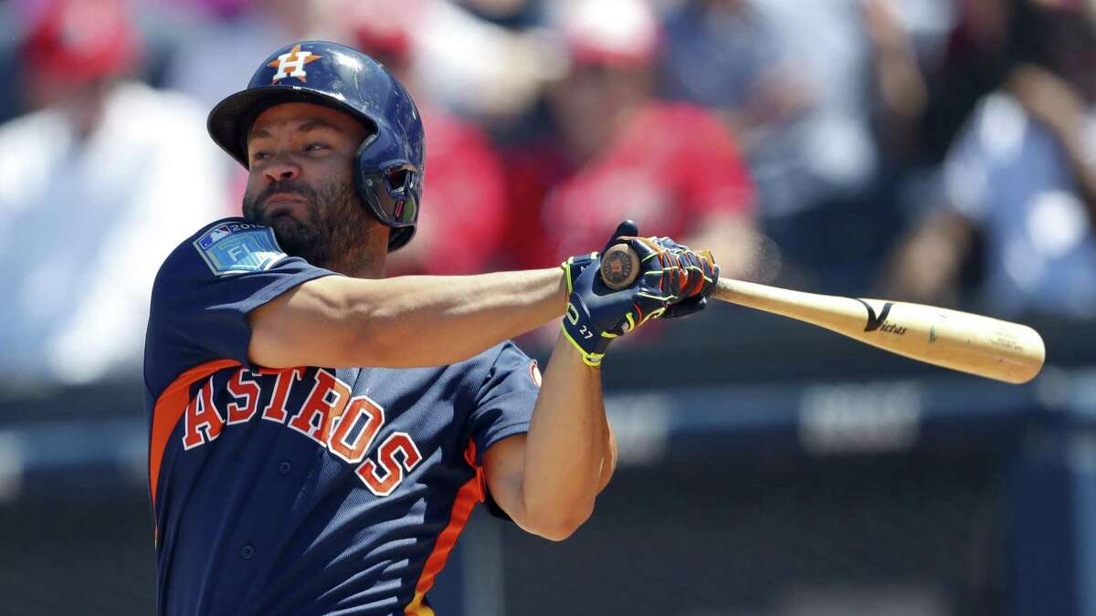 Houston Astros second baseman Jose Altuve (27) bats against the Washington Nationals during a spring training baseball game on March 21, 2018, in West Palm Beach, Fla.