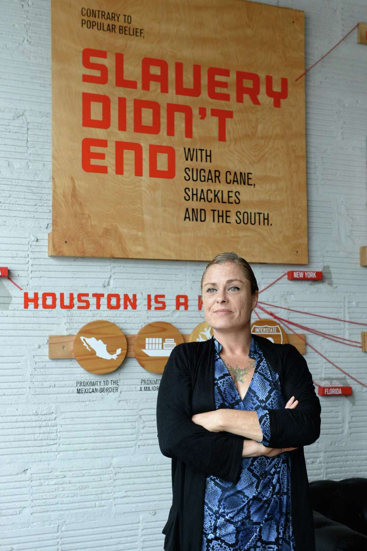 Human trafficking survivor Allison Franklin stands in front a wall display that helps raise awareness about human trafficking at A Second Cup in Houston. A Second Cup is a non-profit coffee shop that raises funds to support survivors of human-trafficking.
