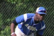Abbott Tech center fielder Jordan O'Brien scoops a grounder during the Class M state baseball tournament quarterfinal game against Lewis Mills at Lewis Mills High School in Burlington June 3, 2017.