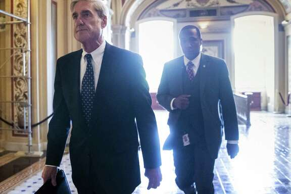 "Special counsel Robert Mueller departs the Capitol after a closed-door June 21, 2017, meeting with members of the Senate Judiciary Committee about Russian meddling in the election and possible connection to the Trump campaign in Washington. The White House is continuing to deny that President Donald Trump is looking to oust Mueller. Spokesman Hogan Gidley tells reporters aboard Air Force One that, ""there are no conversations or discussions about removing"" Mueller."