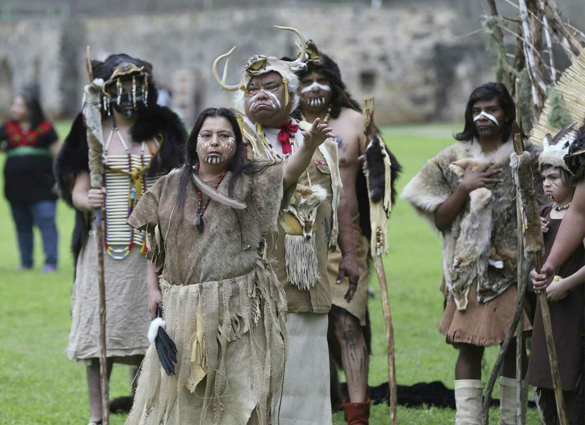 Arlene Lopez (foreground) and others act in a play at the Tricentennial Founders' Feast Day, which commemorated the March 5, 1731, Acto de Posesión, when the Franciscan priests handed over ownership of Missions Concepción, San Juan Capistrano and Espada to the Native American families residing there.